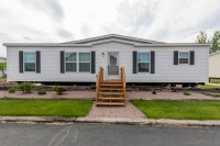 A photo of the front of a Fecteau manufactured home in Vermont.